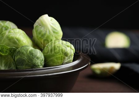 Bowl With Fresh Brussels Sprouts On Table, Closeup
