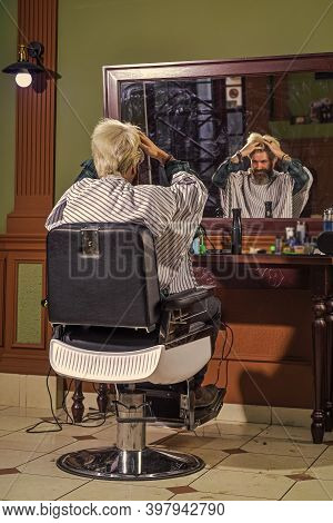 Mr. Expertise. Man In Hair Salon With Hipster Haircut. Beard And Mustaches. Professional Hairstylist