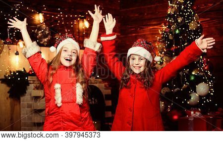 Little Girl Sisters In Red Hats. We Are Family. Elf Children. Xmas. Santa Claus Little Girls Sisters