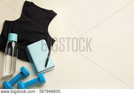 Flat Lay Composition With Sportswear And Notebook On Light Background, Space For Text. Gym Workout P