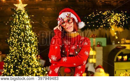 Im Waiting. Happy Woman Celebrate Xmas In Decorated Home. Santa Claus Helper In Hat And Sweater. Win