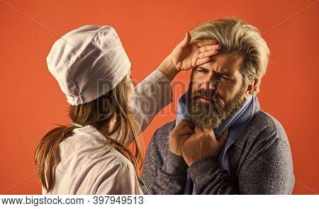 Medical Worker Examining Patient. Patient Care. Diagnostics. Nurse Visiting Unhealthy Man At Home. C