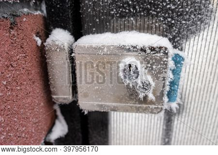 Gas Meter Covered With Snow And Frost. Frozen Gas Meter On The Street.