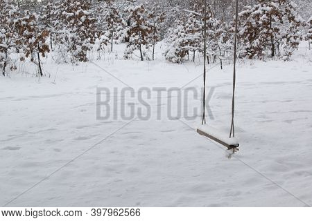 Winter Landscape With Abandoned Tree Swing Covered With Snow. Solitude Concept Mockup