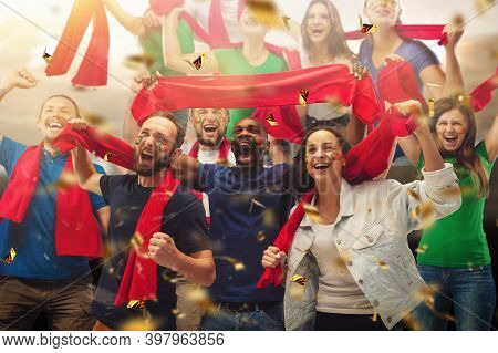 Group Of Happy Fans Cheering For Their Team Victory. Male And Female Models As Fans Of Football Or S