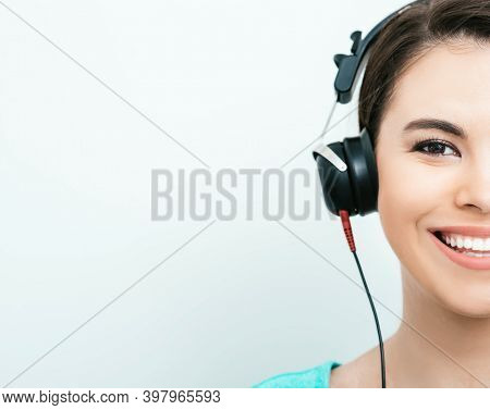 Mixed Race Woman With Toothy Smile Getting A Hearing Test, Audiometer Hearing Test. Half Face, On Gr