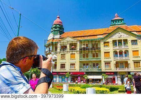 Timisoara, Banat, Romania - June 06, 2015: Photographer Is Taking Photo Of An Old Architecture Of Bu