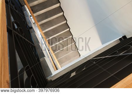 Details Of A New And Modern Stairs In The House, Decorative Gates And Marble Steps.