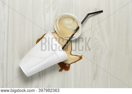 Spilled Cup Of Takeaway Coffee On The Floor