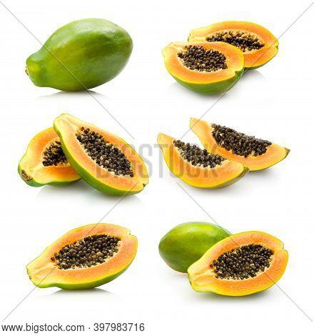 Papaya. Fresh Papaya Fruit Cut In Halves Isolated On White Background With Clipping Path