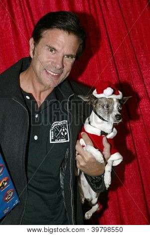 UNIVERSAL CITY - DEC. 4:Lorenzo Lamas & his dog Blueberry arrive at publicist Mike Arnoldi's birthday celebration & Britticares Toy Drive for Children's Hospital on Dec. 4, 2012 in Universal City, CA.