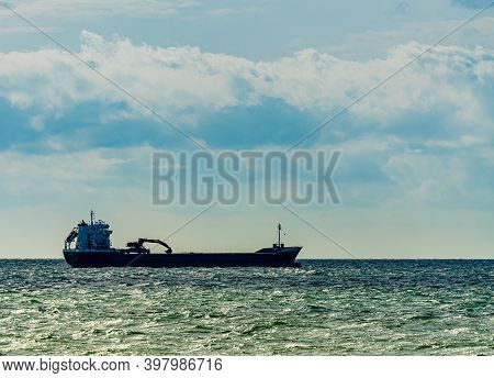 Large Cargo Ship With An Excavator Mounted On Top Of Its Hulls.