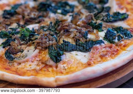 Side View, Italian Pizza With Fried Onions, Green Spinach And Mushrooms On Koh Samui In Thailand