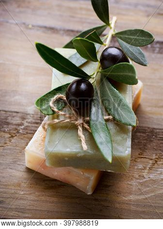 Black Olives And Olive Oil On A Wood Background. Different Types Of Olives And Olive Leaves.