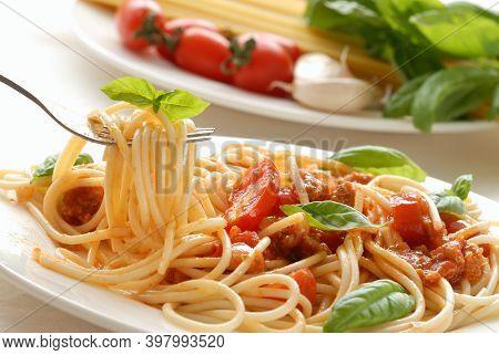 Spaghetti Bolognese, Top View / Spaghetti Italian Pasta Served On White Plates With Tomato Sauce