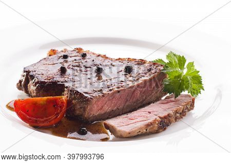 Delicious Steak On A Plate Against A White Background. Steak.