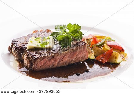 Delicious Steak On A Plate Against A White Background. Delicious Steak.