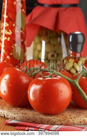 Red Tomatoes On Wooden Background. Homegrown Red Tomato Harvest. Raw Yellow Tomatoes Ready To Eat. R