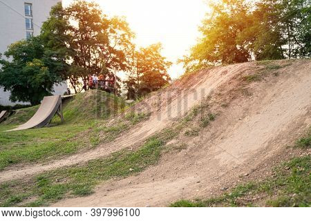 Bmx Springboard Made Of Ground On A Track On Summer In A City On Sunset