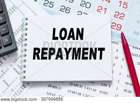 Loan Repayment. Abstract Calendar Close Up Background. Business Concept Written On Notepad With Spac