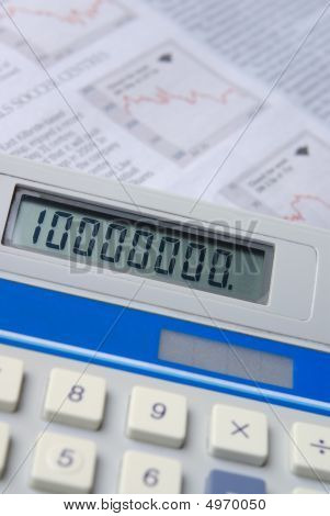 Calculator With Financial Newspaper