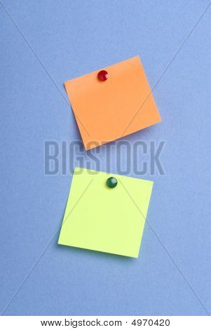 Green And Orange Pinned Postits
