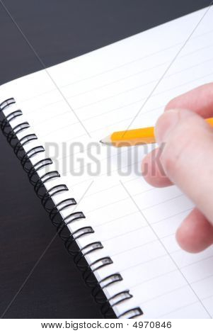 Writing In A Blank Spiral Notebook