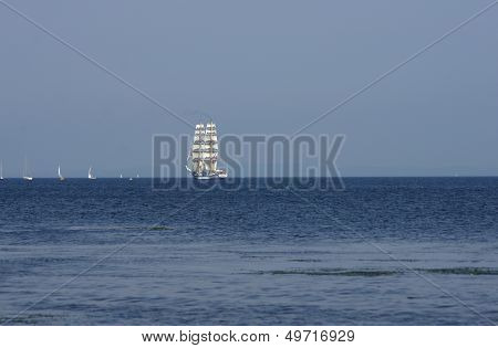 flowing on sea sailing ship on sky background poster