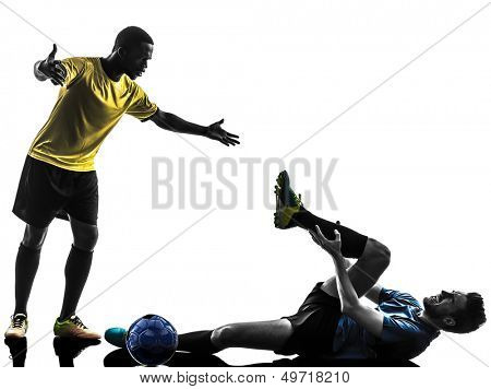 two men soccer player playing football competition complaining foul in silhouette on white background
