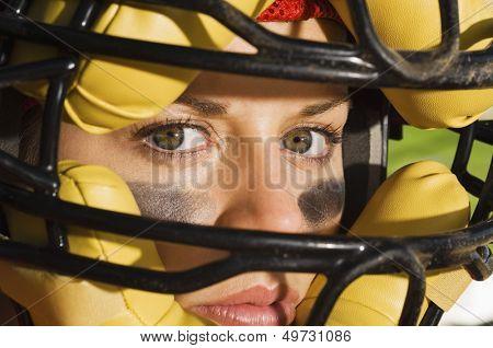 Closeup of confident female catcher wearing mask