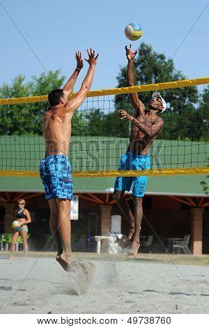 KAPOSVAR, HUNGARY - AUGUST 4: Leonel Munder (R) in action at a ROAK Viragfurdo Kupa beach volleyball competition, August 4, 2013 in Kaposvar, Hungary.