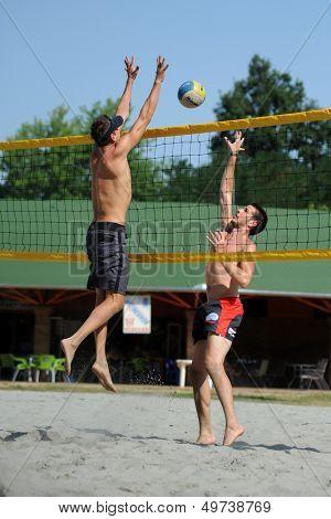 KAPOSVAR, HUNGARY - AUGUST 4: Tamas Kaszap (R) in action at a ROAK Viragfurdo Kupa beach volleyball competition, August 4, 2013 in Kaposvar, Hungary.