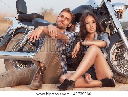Happy Young Love Couple On Scooter Enjoying Themselves On Trip