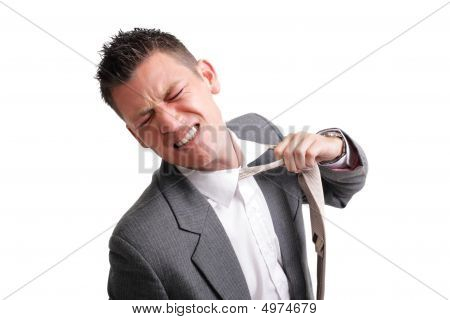 Stressed Businessman Tearing His Tie Off