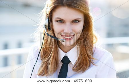 Busy call center agent speaking hands free