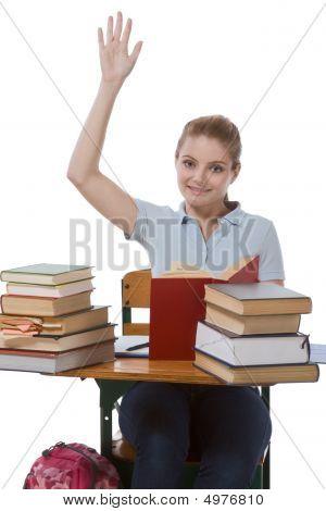 Caucasian Schoolgirl With Raised Hand In Class