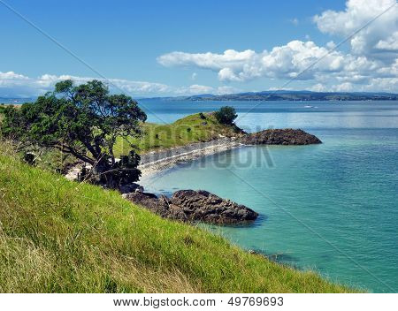 View Onto A Beach With Sea And Islands In The Background