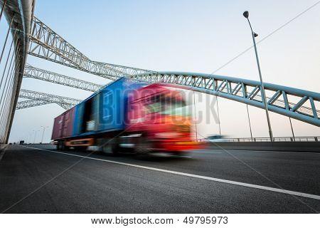 speeding truck go through the bridge.