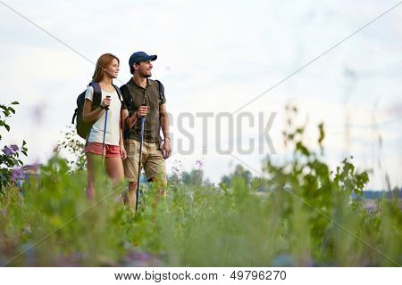 Portrait of two trippers standing in the countryside at summer