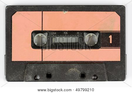 an old retro vintage audio cassette against white poster