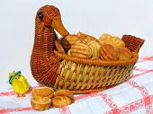 Chicken and a wicker bird filled by cookies with a cream poster