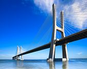 Vasco da Gama bridge spans the Tagus River in Lisbon Portugal. It is the longest bridge in Europe located in Park of Nations. poster