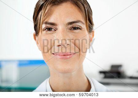 Closeup portrait of confident female technician in hospital