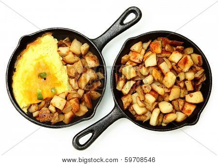 Denver Omelette and Ranch Potatoes in Cast Iron Skillet Isolated.
