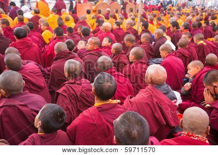 KHATMANDU, NEPAL - DEC 15: Unidentified tibetan Buddhist monks near stupa Boudhanath during festive Puja of H.H. Drubwang Padma Norbu Rinpoche's reincarnation's, Dec 15, 2013 in Khatmandu, Nepal.