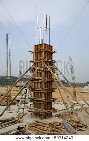 CYBERJAYA, MALAYSIA - CIRCA FEBRUARY 2014: Fabrication of wooden column formwork at construction site. This is temporary formwork to give shape to the column. poster