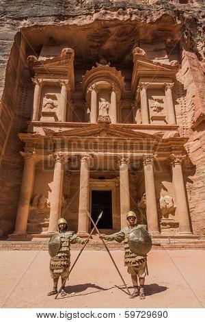 PETRA, JORDAN - MAY 11, 2013: nabatean soldiers in front Al Khazneh or The Treasury