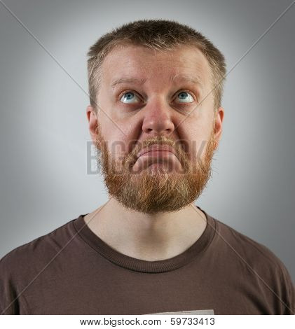 Red-beard Man Looking Up With Discontent