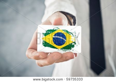 Brazilian Businessman Holding Business Card With Brazil Flag