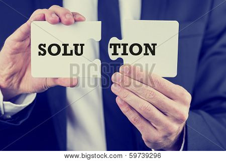 Businessman With The Solution To A Problem